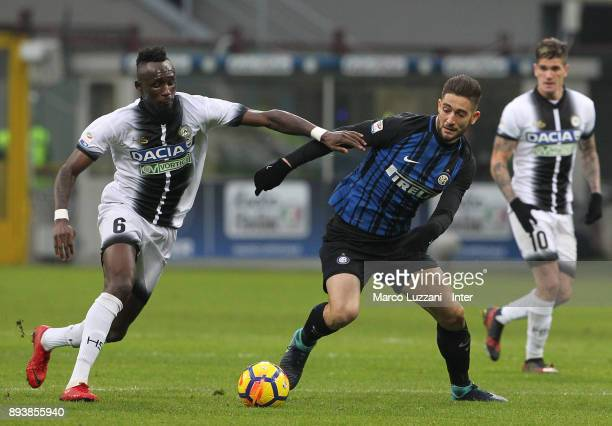 Roberto Gagliardini of FC Internazionale competes for the ball with Jens Seko Fofana of Udinese Calcio during the Serie A match between FC...