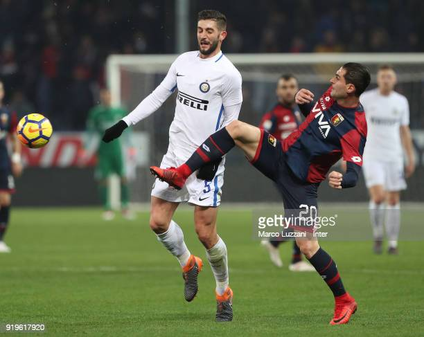 Roberto Gagliardini of FC Internazionale competes for the ball with Aleandro Rosi of Genoa CFC during the serie A match between Genoa CFC and FC...