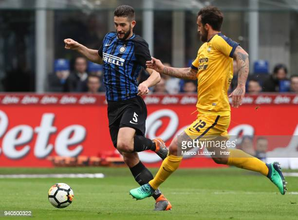 Roberto Gagliardini of FC Internazionale competes for the ball with Antonio Caracciolo of Hellas Verona FC during the serie A match between FC...