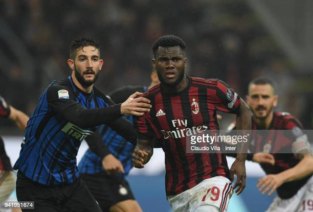 Roberto Gagliardini of FC Internazionale competes for the ball with Franck Kessie of AC Milan during the serie A match between AC Milan and FC...