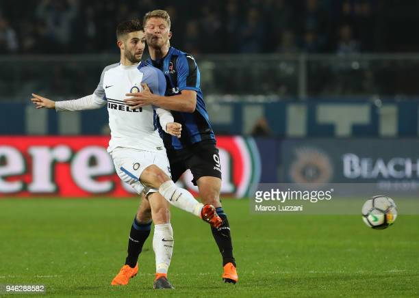 Roberto Gagliardini of FC Internazionale competes for the ball with Andreas Cornelius of Atalanta BC during the serie A match between Atalanta BC and...