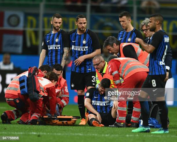 Roberto Gagliardini of FC Internazionale gets on a stretcher during the serie A match between FC Internazionale and Cagliari Calcio at Stadio...