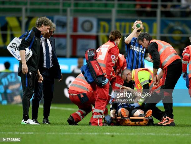 Roberto Gagliardini of FC Internazionale leaves the pitch on a stretcher during the serie A match between FC Internazionale and Cagliari Calcio at...