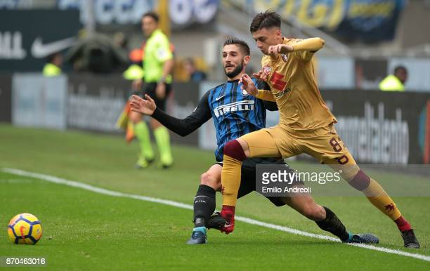 Roberto Gagliardini of FC Internazionale Milano competes for the ball with Daniele Baselli of Torino FC during the Serie A match between FC...