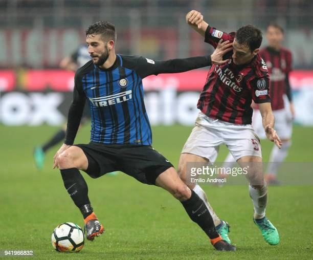 Roberto Gagliardini of FC Internazionale Milano competes for the ball with Giacomo Bonaventura of AC Milan during the serie A match between AC Milan...