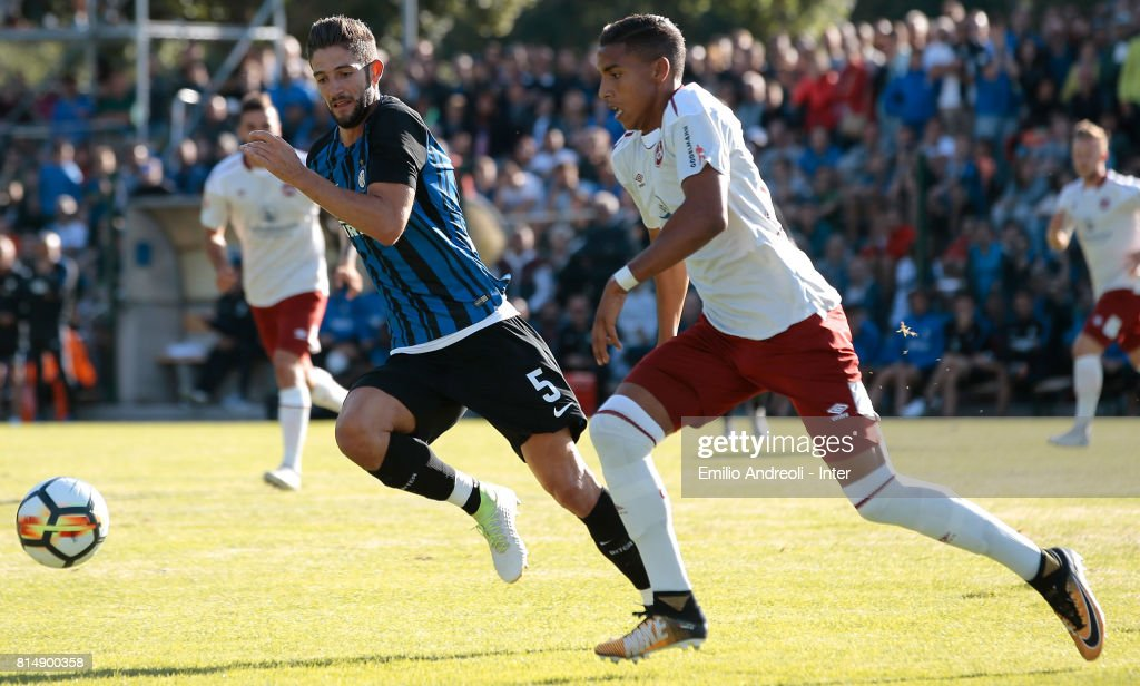 Roberto Gagliardini of FC Internazionale Milano (L) is challenged by Abdelhamid Sabiri of Nurnberg during the Pre-Season Friendly match between FC Internazionale and Nurnberg on July 15, 2017 in Bruneck, Italy.