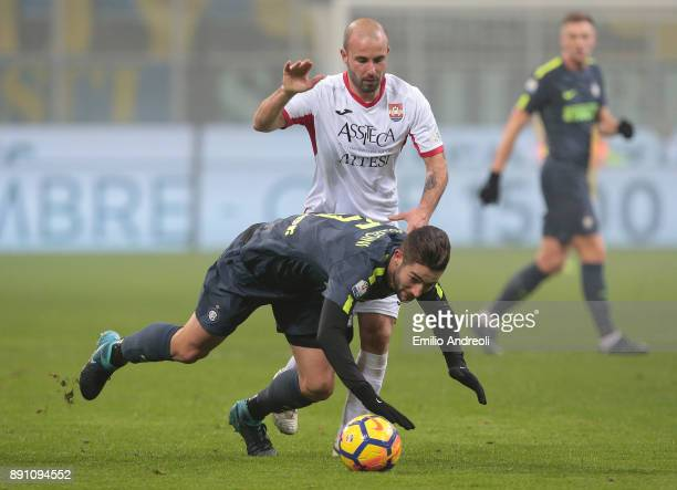 Roberto Gagliardini of FC Internazionale Milano is challenged by Emanuele Berrettoni of Pordenone Calcio during the TIM Cup match between FC...