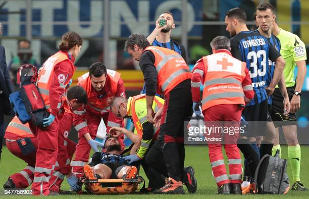 Roberto Gagliardini of FC Internazionale Milano receives medical care during the serie A match between FC Internazionale and Cagliari Calcio at...