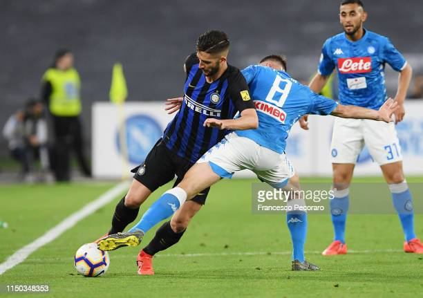 Roberto Gagliardini of FC Internazionale vies with Fabian Ruiz of SSC Napoli during the Serie A match between SSC Napoli and FC Internazionale at...