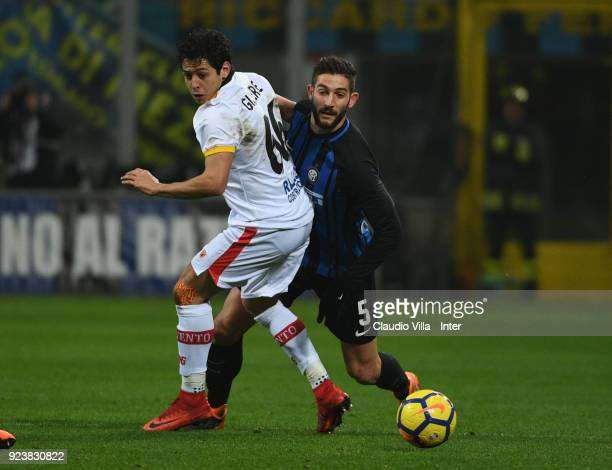 Roberto Gagliardini of FC of Internazionale competes for the ball with Guilherme of Benevento Calcio during the serie A match between FC...
