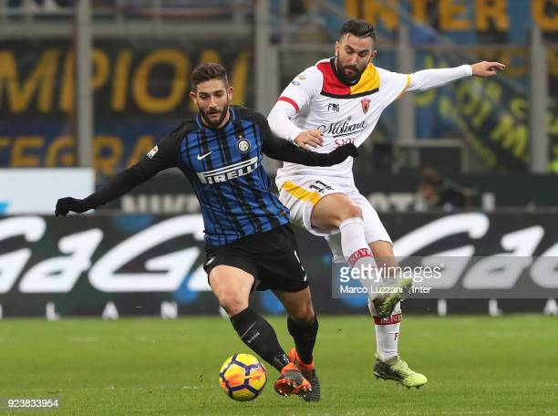 Roberto Gagliardini of FC of Internazionale competes for the ball with Massimo Coda of Benevento Calcio during the serie A match between FC...