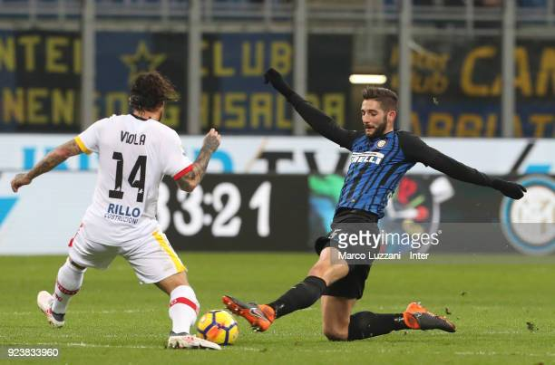 Roberto Gagliardini of FC of Internazionale competes for the ball with Benito Nicolas Viola of Benevento Calcio during the serie A match between FC...