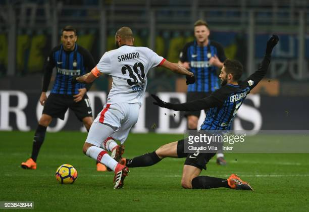 Roberto Gagliardini of FC of Internazionale competes for the ball with Sandro of Benevento Calcio during the serie A match between FC Internazionale...