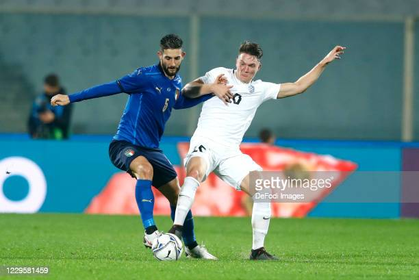Roberto Gagliardini of Italy and Mihkel Ainsalu of Estonia battle for the ball during the International Friendly match between Italy and Estonia at...