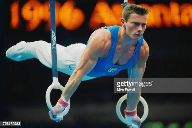 Roberto Galli of Italy performs his Rings routine during the Men's artistic team allaround competition of the XXVI Summer Olympic Games on 22 July...