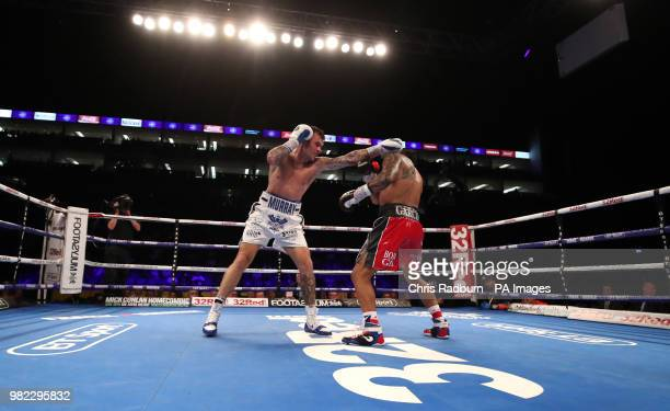 Roberto Garcia and Martin Murray during the The WBC Silver Middleweight Championship at The O2 London