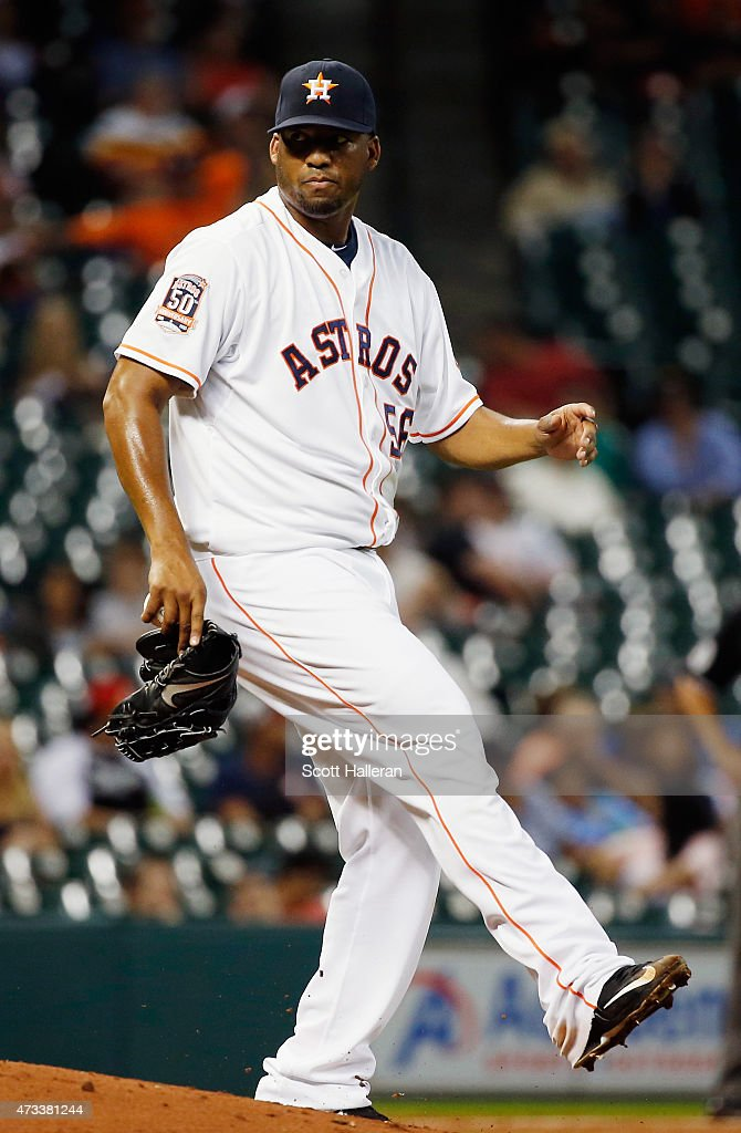 Roberto Hernandez #56 of the Houston Astros kicks the pitchers mound after allowing a un in the third inning of their game against the Toronto Blue Jays at Minute Maid Park on May 14, 2015 in Houston, Texas.