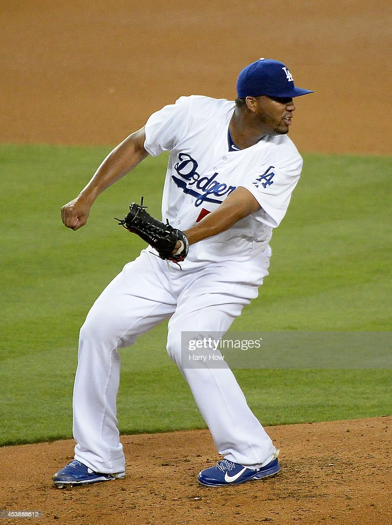 Roberto Hernandez #55 of the Los Angeles Dodgers reacts to single by Yasmani Grandal #8 of the San Diego Padres during the third inning at Dodger Stadium on August 20, 2014 in Los Angeles, California.