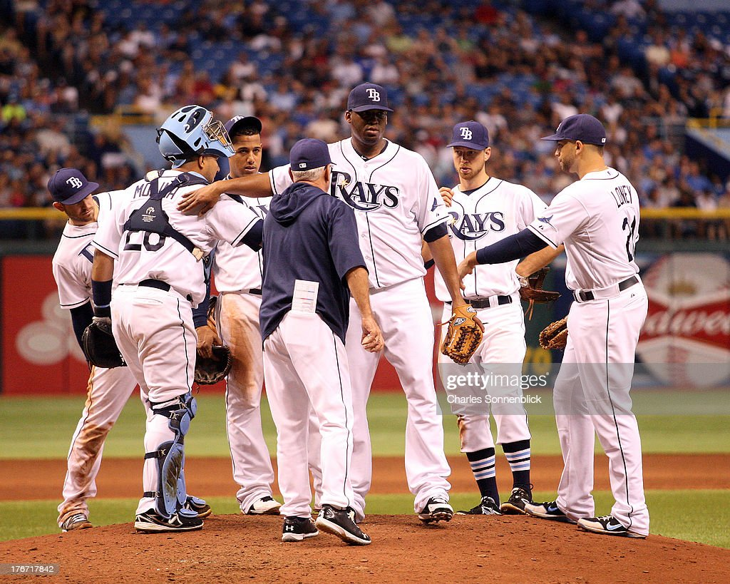 Roberto Hernandez #40 of the Tampa Bay Rays is taken out of the game by Joe Maddon in the sixth inning against the Toronto Blue Jays during the game on August 17, 2013 at Tropicana Field in St. Petersburg, Florida.
