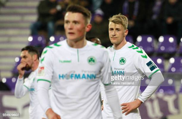 Roberto Hilbert Fabian Reese and Lukas Gugganig of Fuerth look dejected during the second Bundesliga match between FC Erzgebirge Aue and SpVgg...