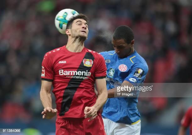 Roberto Hilbert of Leverkusen and Abdou Diallo of Mainz battle for the ball during the Bundesliga match between Bayer 04 Leverkusen and 1 FSV Mainz...