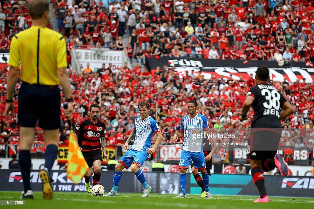 Roberto Hilbert of Leverkusen (2nd L) challenges Eugen Polanski of Hoffenheim (3rd L) during the Bundesliga match between Bayer Leverkusen and 1899 Hoffenheim at BayArena on August 15, 2015 in Leverkusen, Germany.