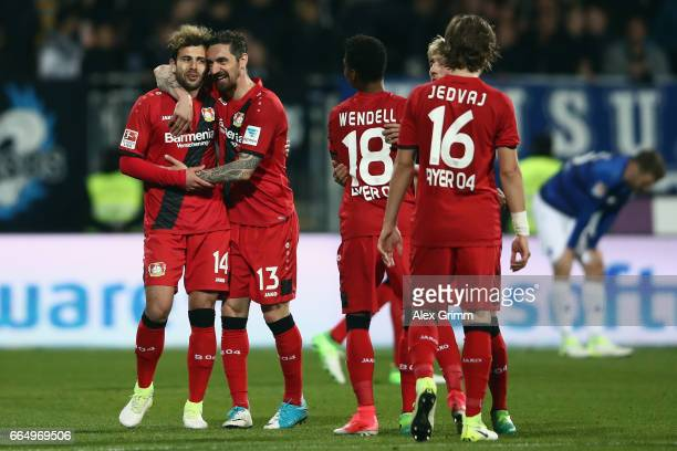 Roberto Hilbert of Leverkusen hugs Admir Mehmedi after the Bundesliga match between SV Darmstadt 98 and Bayer 04 Leverkusen at Jonathan Heimes...