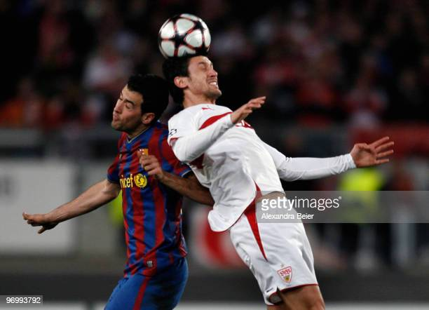Roberto Hilbert of VfB Stuttgart heads for the ball with Sergio Busquets of FC Barcelona during the UEFA Champions League round of sixteen first leg...
