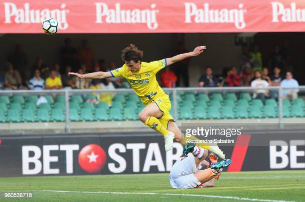 Roberto Inglese AC Chievo Verona competes for the ball with Christian Puggioni of Benevento Calcio during the Serie A match between AC Chievo Verona...