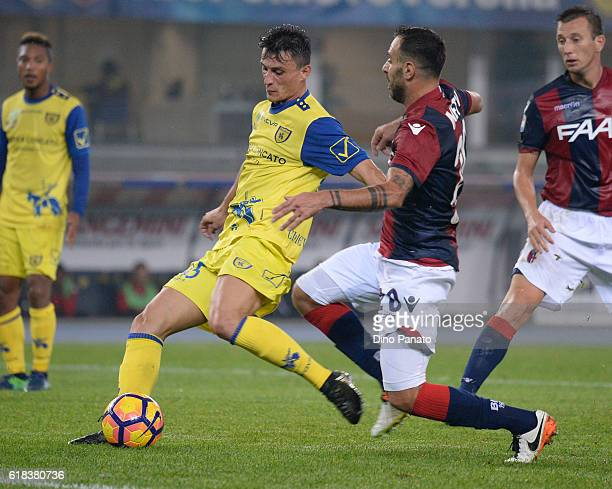 Roberto Inglese of AC ChievoVerona competes with Daniele Gastaldello of Bologna FC during the Serie A match between AC ChievoVerona and Bologna FC at...