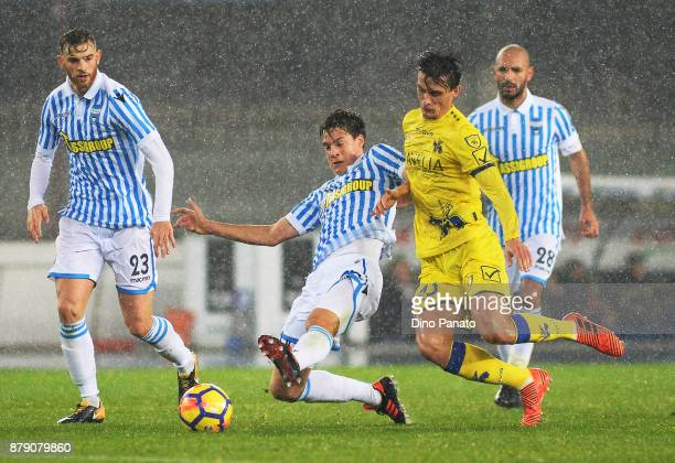 Roberto Inglese of Chievo Verona competes with Francesco Viccari of Spal during the Serie A match between AC Chievo Verona and Spal at Stadio...