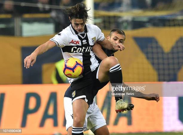 Roberto Inglese of Parma Calcio and Danilo of Bologna FC in action during the Serie A match between Parma Calcio and Bologna FC at Stadio Ennio...