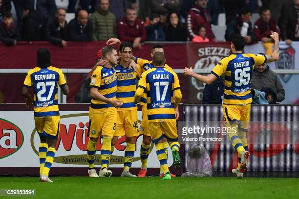 Roberto Inglese of Parma Calcio celebrates a goal with team mates during the Serie A match between Torino FC and Parma Calcio at Stadio Olimpico di...