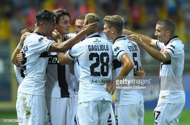 Roberto Inglese of Parma Calcio celebrates after scoring the opening goal with team mates during the serie A match between Parma Calcio and Udinese...