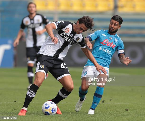 Roberto Inglese of Parma Calcio competes for the ball with Lorenzo Insigne of SSC Napoli during the Serie A match between Parma Calcio and SSC Napoli...