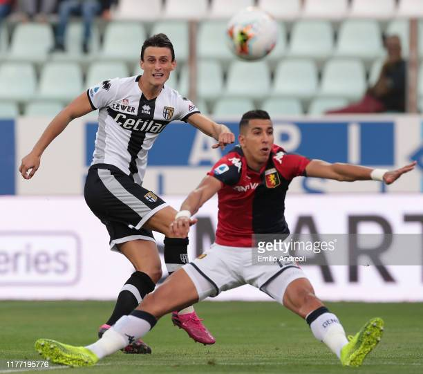 Roberto Inglese of Parma Calcio is challenged by Jawad El Yamiq of Genoa CFC during the Serie A match between Parma Calcio and Genoa CFC at Stadio...