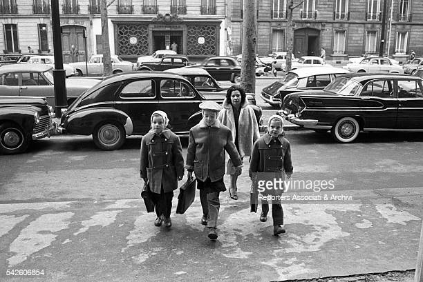 Roberto jr Isabella and Isotta Ingrid Rossellini coming out of school Rome 1959