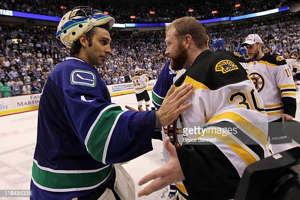 Roberto Luongo of the Vancouver Canucks congratulates Tim Thomas of the Boston Bruins after defeating the Vancouver Canucks in Game Seven of the 2011...