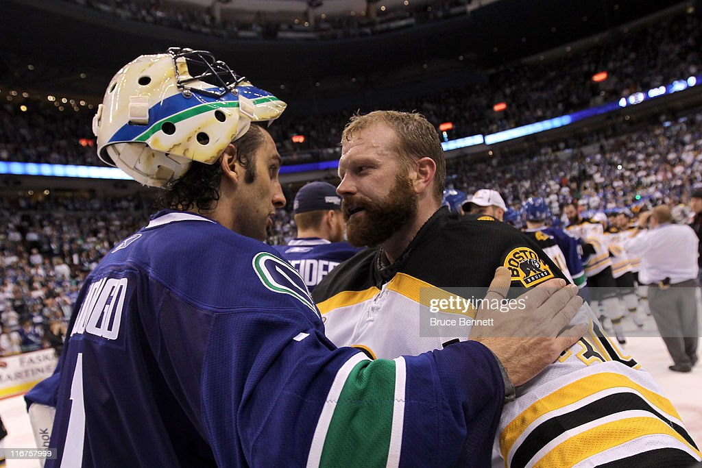 Roberto Luongo Of The Vancouver Canucks Congratulates Tim Thomas Of