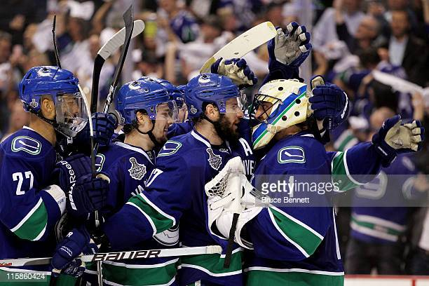 Roberto Luongo Alexander Edler and Ryan Kesler and the Vancouver Canucks celebrate after defeating the Boston Bruins by a score of 10 in Game Five of...