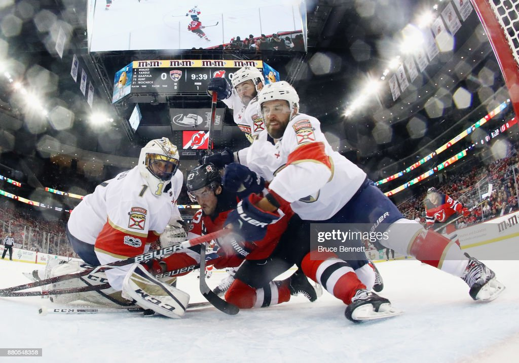 Roberto Luongo #1 and Aaron Ekblad #5 of the Florida Panthers defend the net against Stefan Noesen #23 of the New Jersey Devils during the first period at the Prudential Center on November 27, 2017 in Newark, New Jersey.