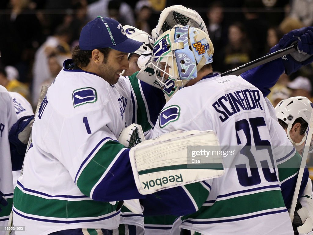 Roberto Luongo #1 congratulates Cory Schneider #35 of the Vancouver Canucks after the win over the Boston Bruins on January 7, 2012 at TD Garden in Boston, Massachusetts. The Vancouver Canucks defeated the Boston Bruins 4-3.
