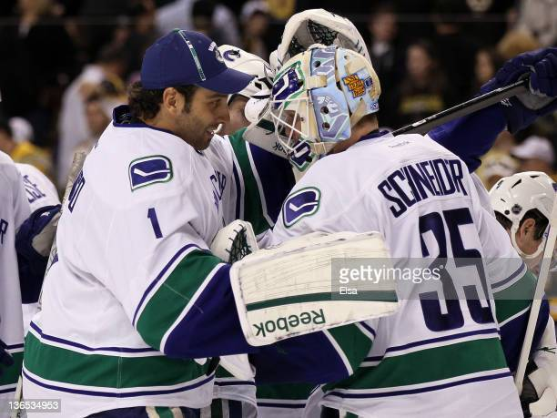 Roberto Luongo congratulates Cory Schneider of the Vancouver Canucks after the win over the Boston Bruins on January 7 2012 at TD Garden in Boston...