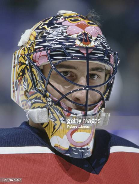 Roberto Luongo, Goalkeeper for the Florida Panthers looks out from behind his face mask as he tends goal during the NHL Western Conference, Pacific...