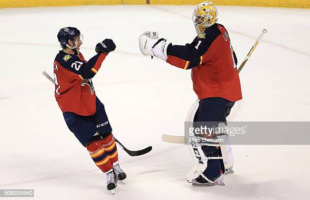 Roberto Luongo is congratulated by Vincent Trocheck of the Florida Panthers after winning a game against the Chicago Blackhawks at BBT Center on...