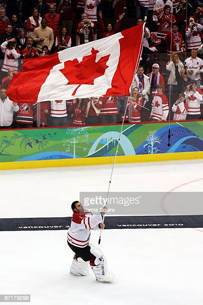 Roberto Luongo of Canada celebrates with the flag after winning the gold medal in the ice hockey men's gold medal game between USA and Canada on day...