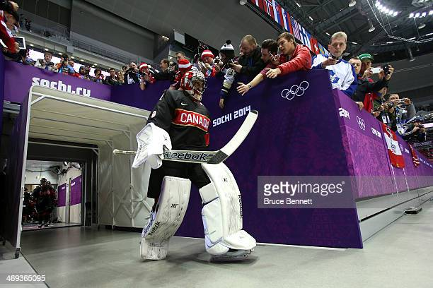 Roberto Luongo of Canada high fives fans prior to the Men's Ice Hockey Preliminary Round Group B game against Austria on day seven of the Sochi 2014...