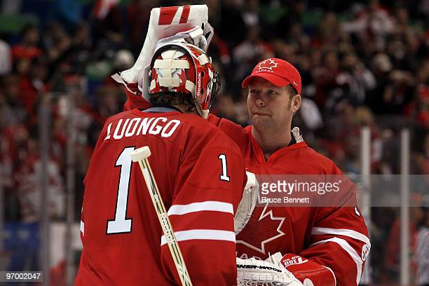 Roberto Luongo of Canada is greeted by teammate Martin Brodeur after their game against Germany during the ice hockey Men's Qualification Playoff...