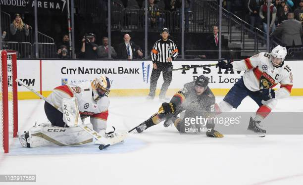 Roberto Luongo of the Florida Panthers blocks a shot by Shea Theodore of the Vegas Golden Knights as Aleksander Barkov of the Panthers defends in...