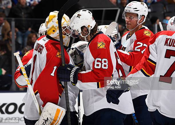 Roberto Luongo of the Florida Panthers celebrates the win with Jaromir Jagr of the Florida Panthers at the end of a game against the Toronto Maple...